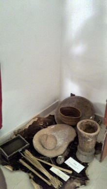 Kitchen equipment. I see a grinding stone and other I don't know what